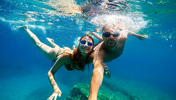 Couple taking an underwater selfie in Sri Lanka