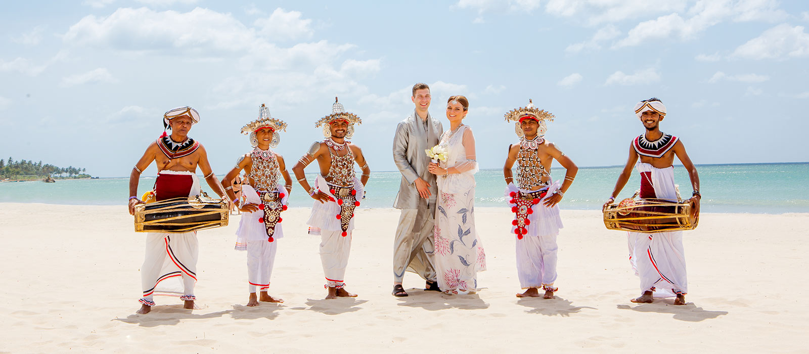 Couple with Tranditional Dancers in Sri Lanka